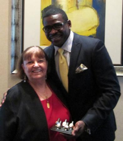 Avril with Michael Irvin - Pro Football Hall of Famer displaying his rings