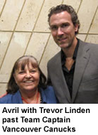 Avril with Trevor Linden past Team Captain Vancouver Canucks